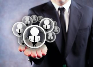 Businessman Holding Virtual Social Media Icons on Outstreched Hand